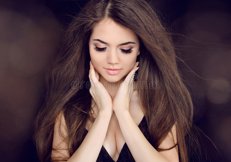 Beautiful woman with long brown hair. Fashion long hairstyles. Wellness stock photo