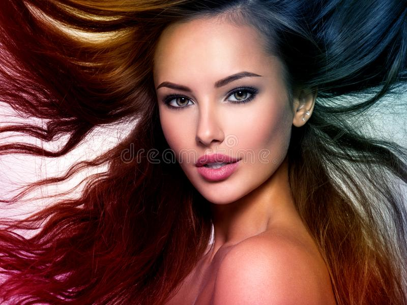 Beautiful woman with long brown hair. Tinted art photo stock image