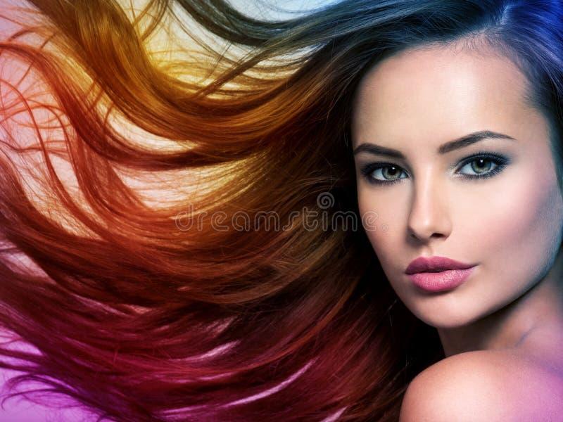 Beautiful woman with long brown hair. Tinted art photo royalty free stock photos