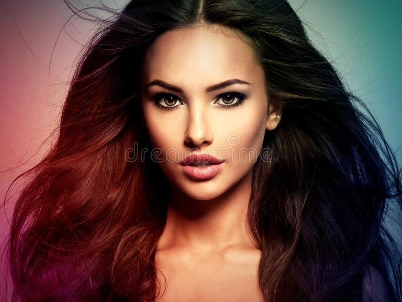 Beautiful woman with long brown hair. Tinted art photo stock photos