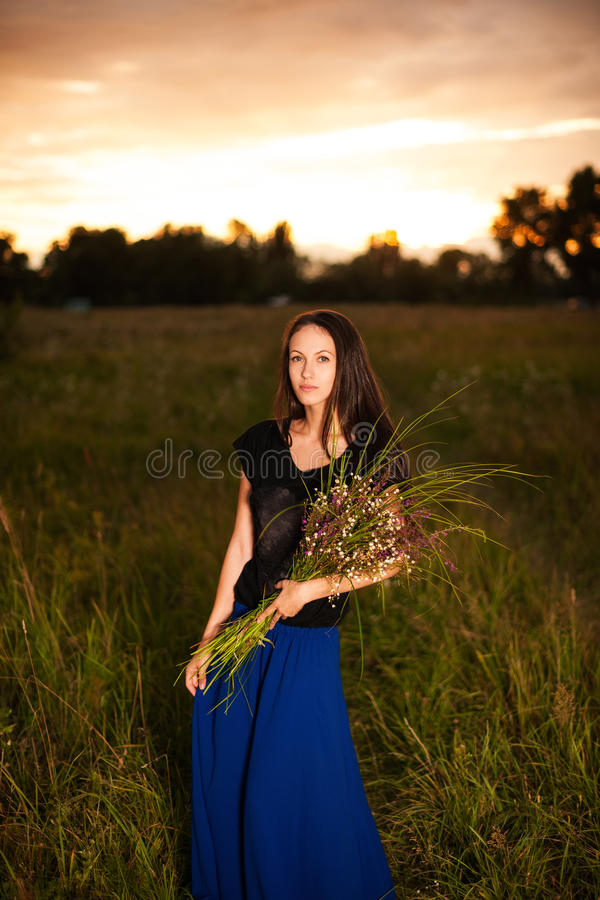 Beautiful Woman In Long Dress Holding Bouquet Of Wild