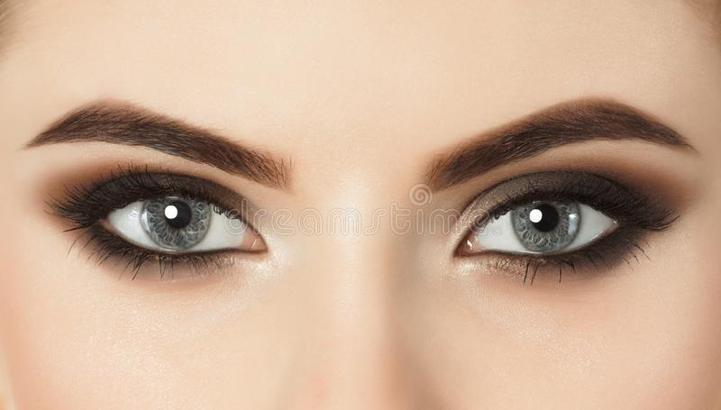 Beautiful woman with long eyelashes and with beautiful evening make-up. royalty free stock image
