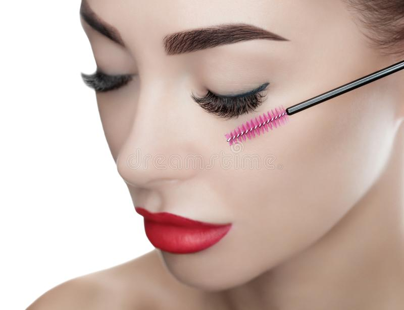 Beautiful Woman with long eyelashes in a beauty salon. Eyelash extension procedure. royalty free stock photography