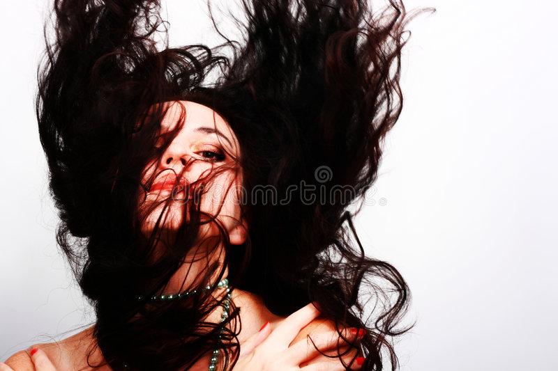 Beautiful woman with long flying hair stock photography