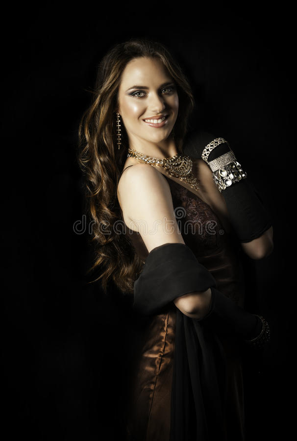 Beautiful woman with long hair in couture dress royalty free stock photography