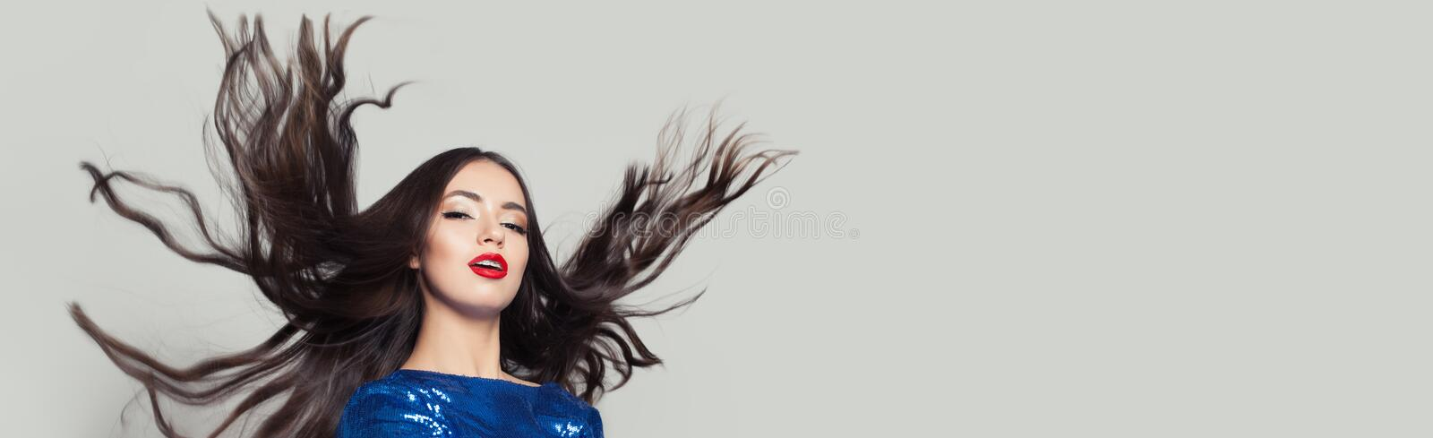 Beautiful woman with long healthy blowing hair on white stock photos