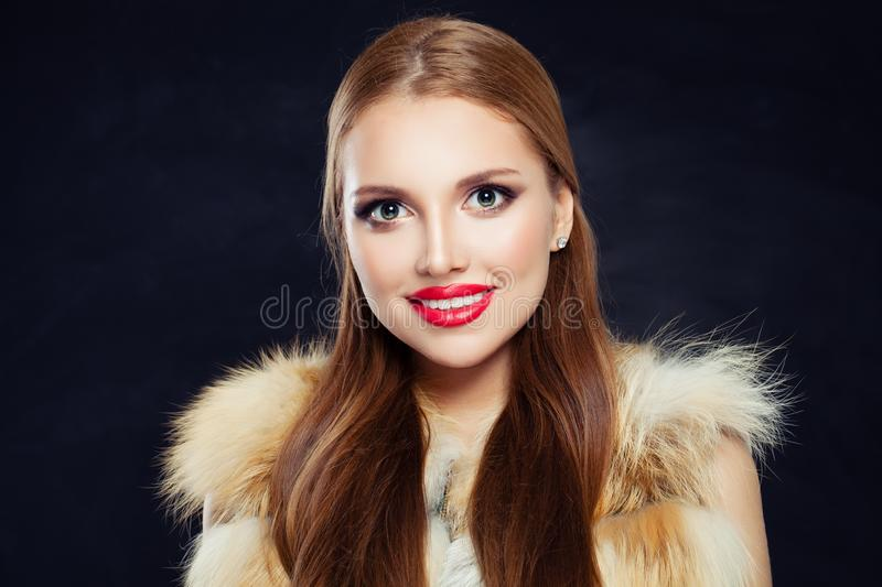 Beautiful woman with long healthy straight hair and makeup on black background stock photos