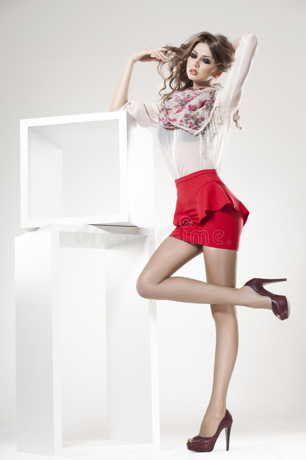 Beautiful woman with long legs dressed elegant stock image