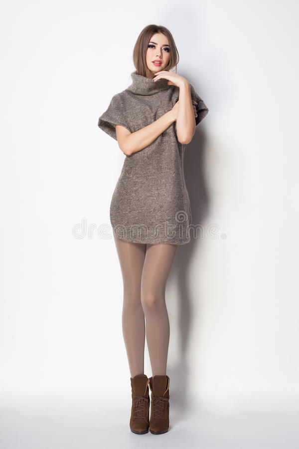 Beautiful woman with long legs dressed elegant posing royalty free stock images
