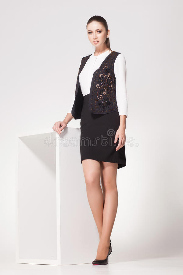 Beautiful Woman With Long Legs Dressed Elegant Posing In The Studio Stock Photo -4627