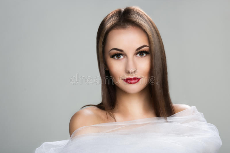 Beautiful woman with long straight brown hair royalty free stock photo