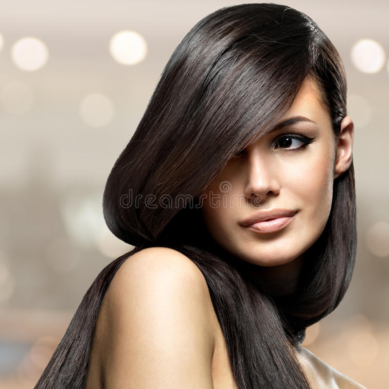 Beautiful woman with long straight hair stock photography