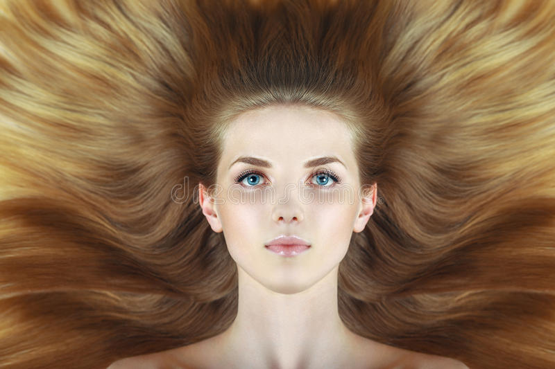 Beautiful woman with long wave blond hairs stock photos