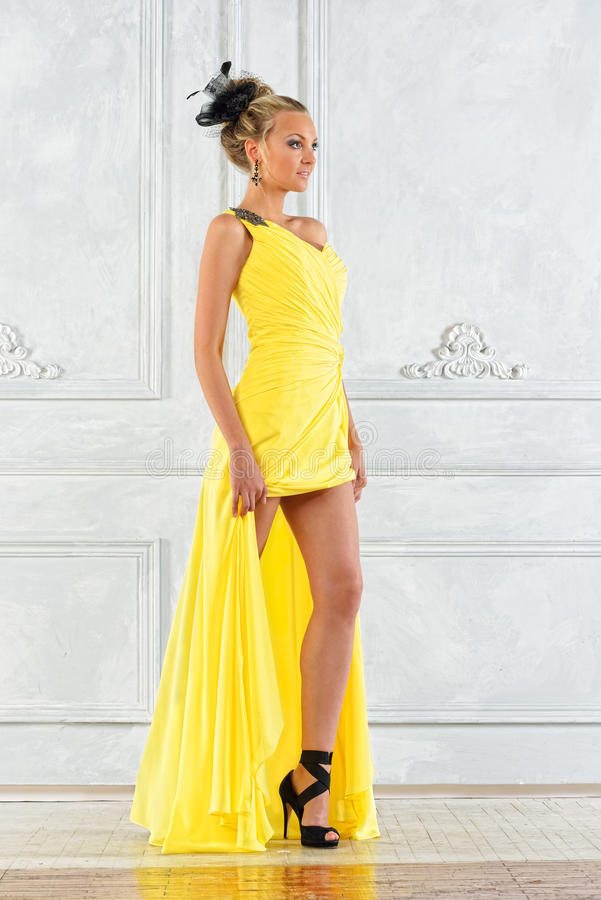 Download Beautiful Woman In A Long Yellow Dress. Stock Image - Image: 26532221