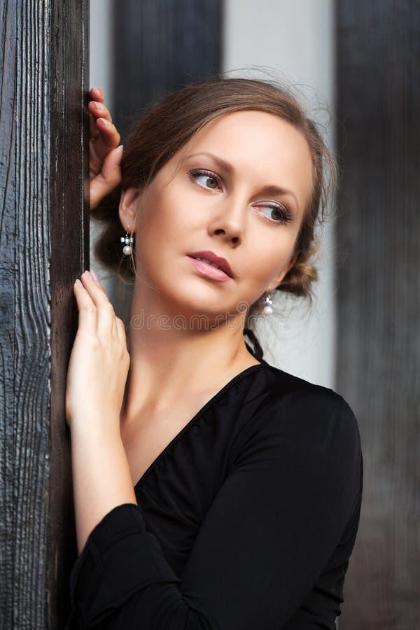 Beautiful fashion woman looking away royalty free stock photography