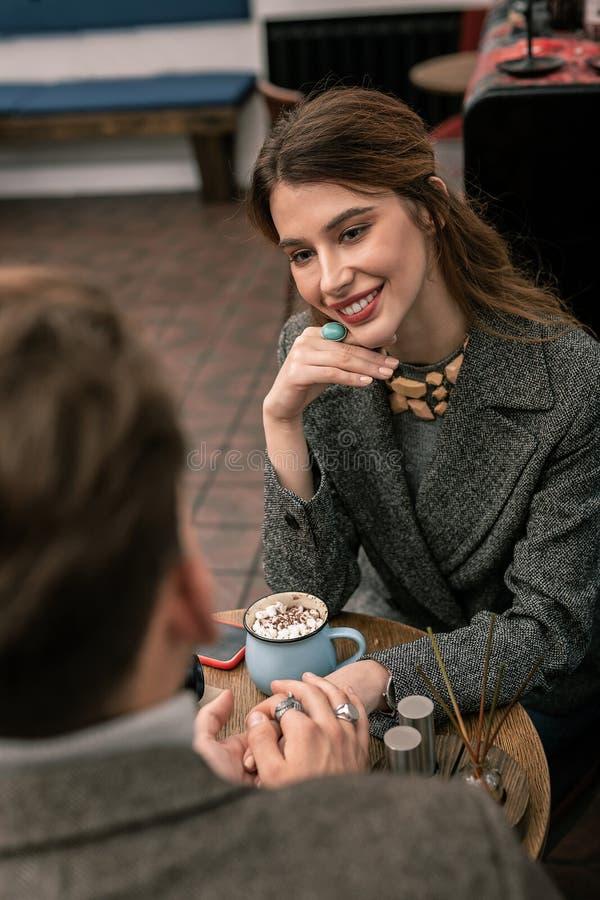 Beautiful woman looking at her partner during romantic conversation. Romantic talk. A beautiful women looking on her partner during romantic conversation royalty free stock image