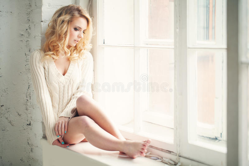 Beautiful Woman Looking out the Window stock photos