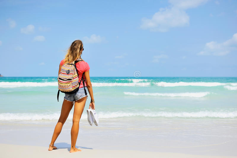 Beautiful woman looking at the sea. Travel and vacation stock image