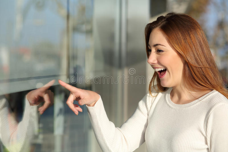 Beautiful woman looking a storefront surprised stock photo