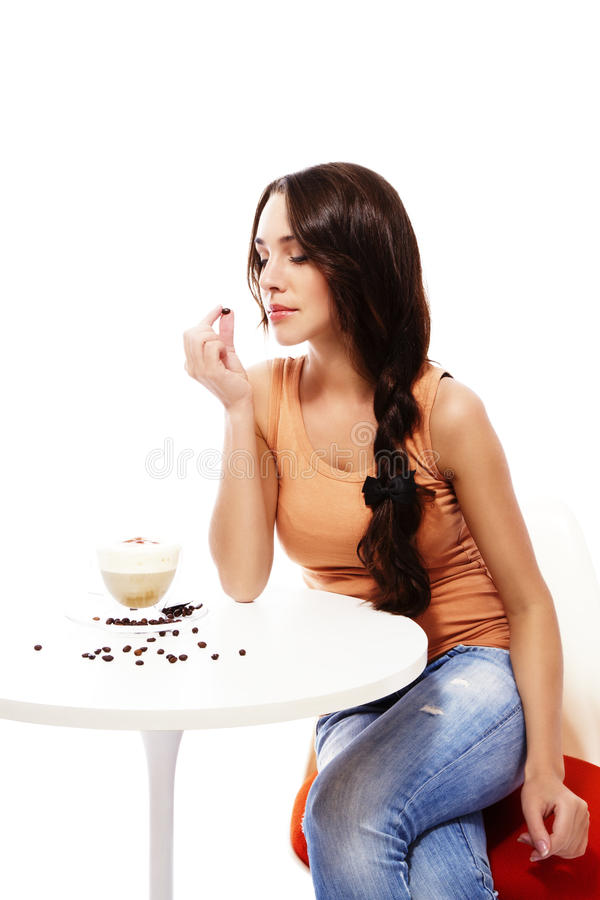 Download Beautiful Woman Looking To A Coffee Bean In Her Ha Stock Image - Image: 23559635