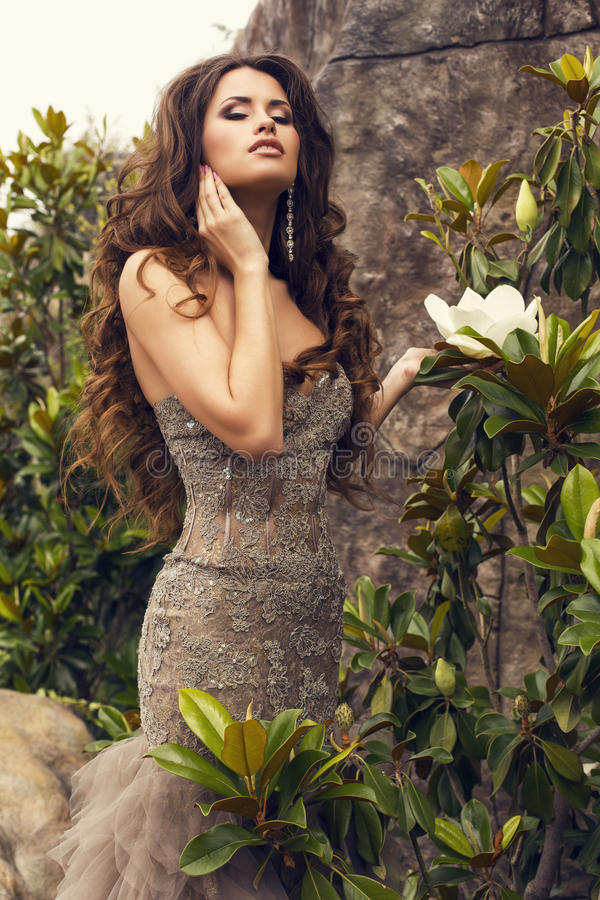 Beautiful woman with luxurious long hair in elegant sequin dress royalty free stock photos