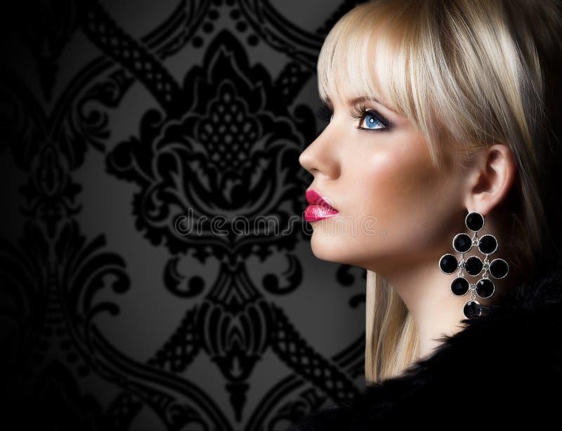 Beautiful woman in luxury fur coat royalty free stock photography