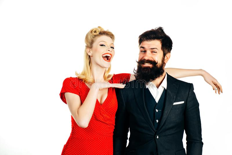 Beautiful woman with luxury hairstyle wearing red dress and handsome bearded man isolated at white background. Crazy royalty free stock photos