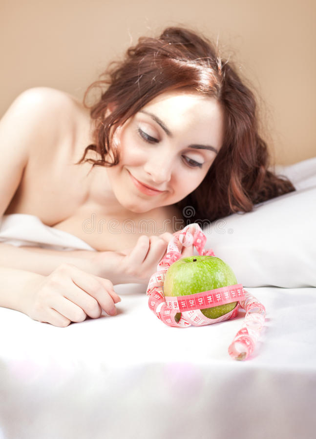 Download Beautiful Woman Lying In Bed With Green Apple Stock Image - Image: 19627185