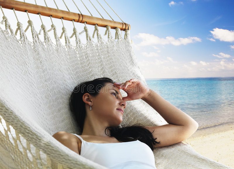 Beautiful woman lying in hammock royalty free stock photos