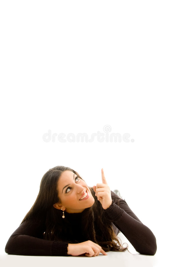 Beautiful woman lying and pointing upwards royalty free stock photos