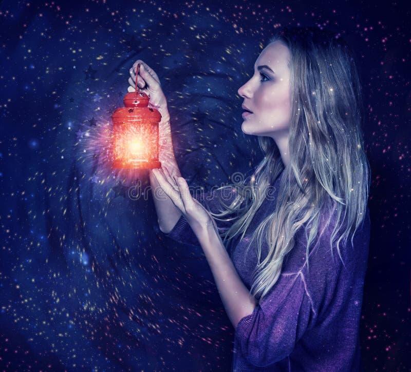 Beautiful woman with magic lantern stock photos