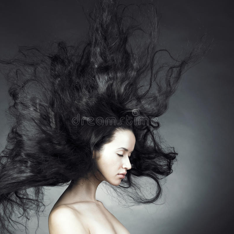 Beautiful woman with magnificent hair stock photography