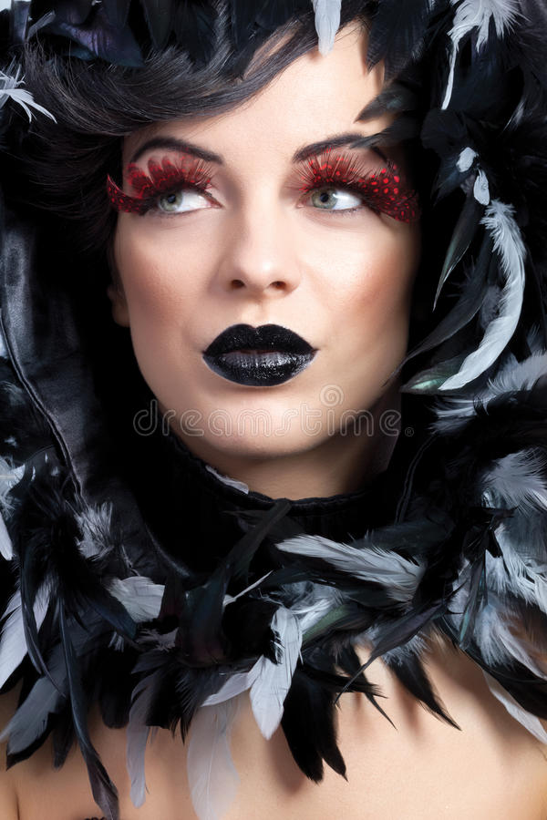 Beautiful woman make up concept. And feathers around the neck and head stock photo