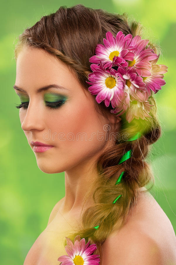 Beautiful woman with makeup and flowers royalty free stock photo