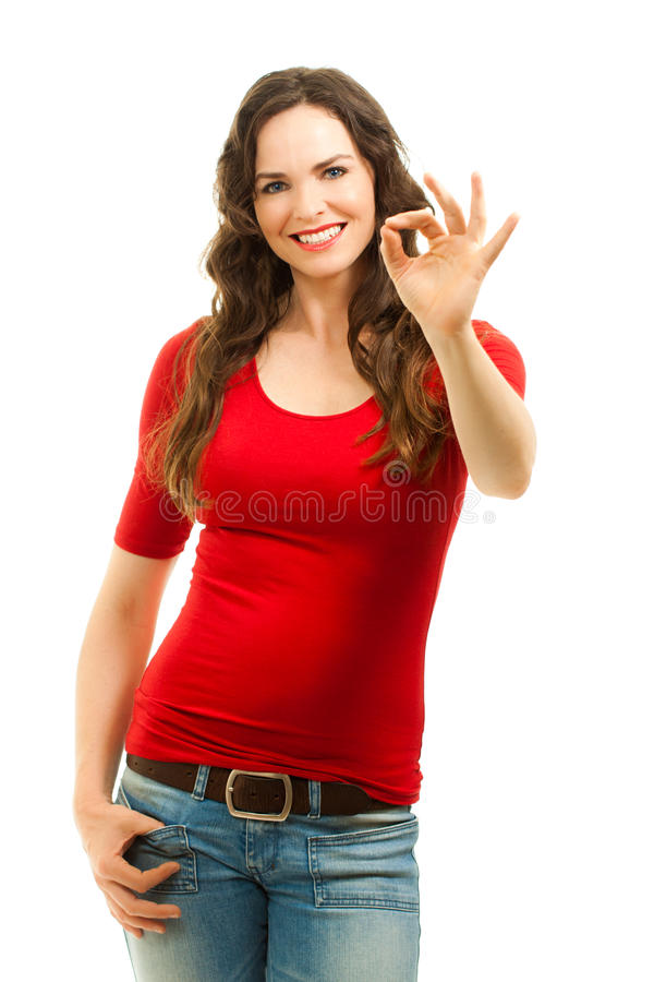 Beautiful woman making an OK sign stock photography