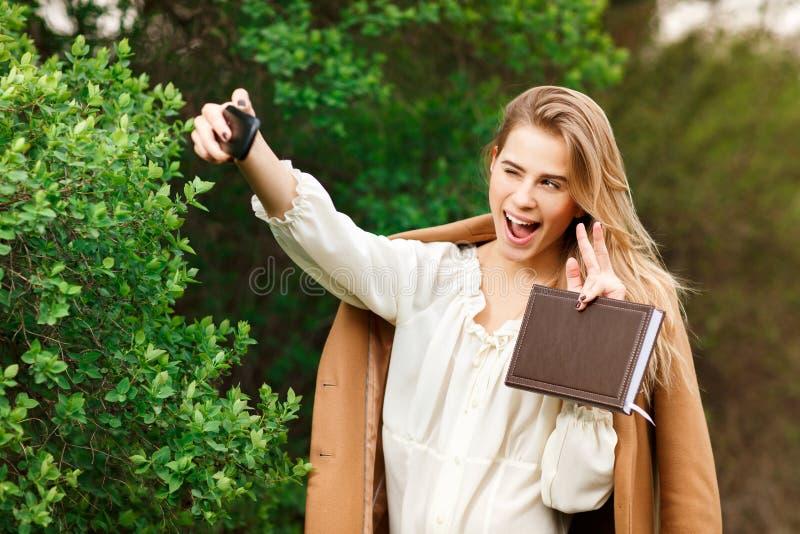 Beautiful woman making selfie stock photography