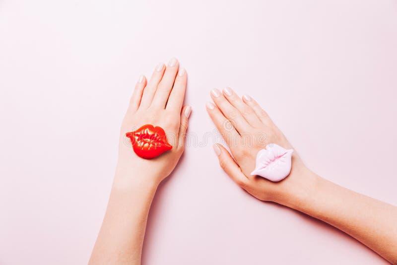 Beautiful woman manicure on creative pink background. Minimalist trend royalty free stock photography