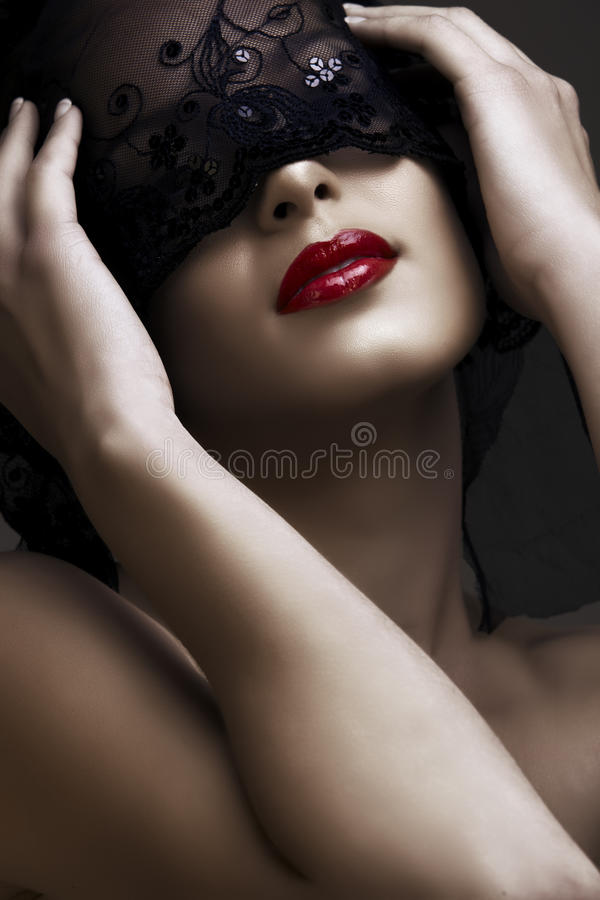 Beautiful woman with mask stock photos