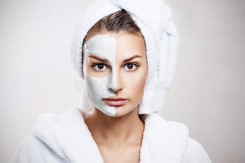Beautiful woman with mask on her face. royalty free stock photography