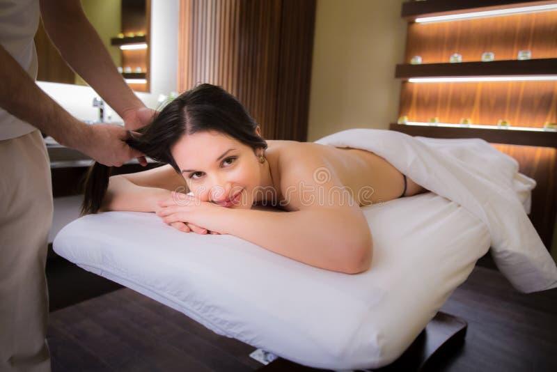 Beautiful woman on massage bed. stock photography