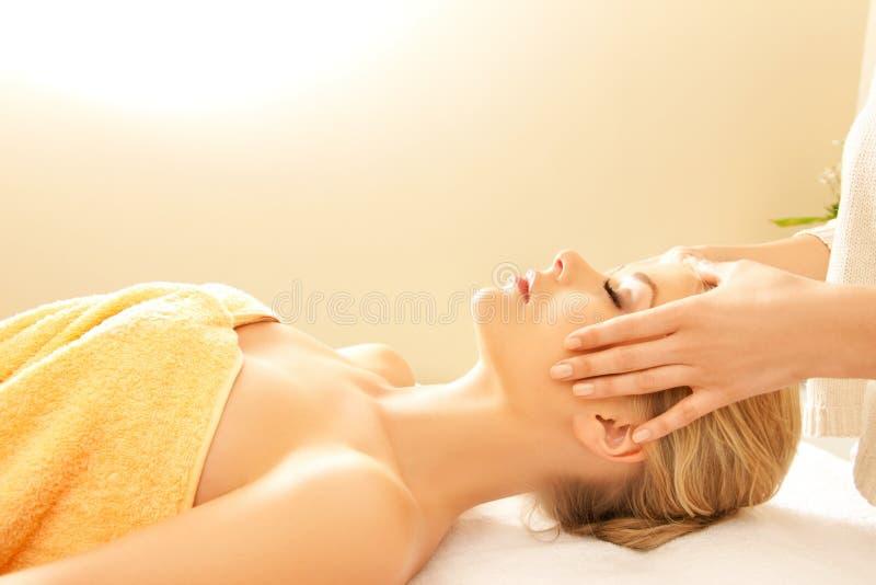 Beautiful woman in massage salon stock images
