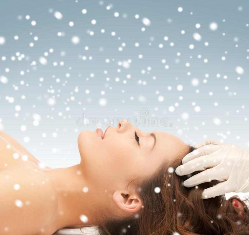 Beautiful woman in massage salon with snow. Picture of beautiful woman in massage salon with snow royalty free stock images