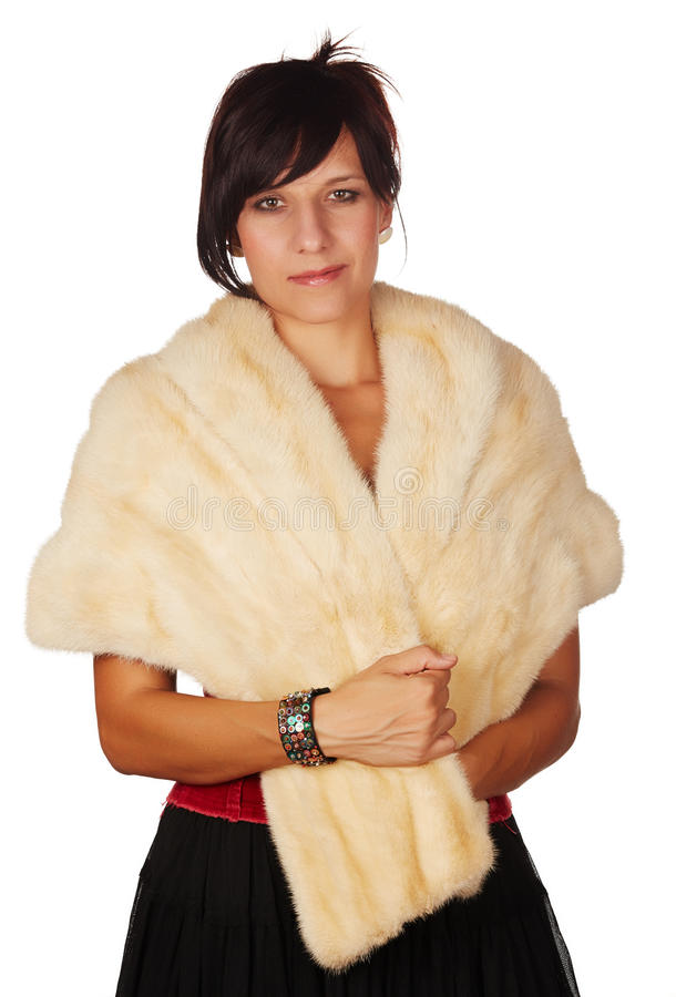Beautiful woman. Beautiful and mature adult caucasian woman with red lips, dark hair and brown eyes wearing a faux fur shawl against a neutral background royalty free stock image