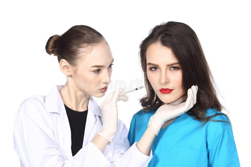 Beautiful Woman with Medical healthy beauty Injection Treatment. Caucasian Beautiful Doctor with Medical healthy beauty Injection Treatment check nose skin shape royalty free stock photo