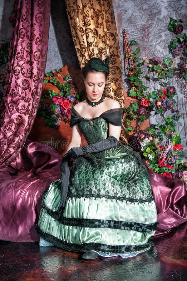 Beautiful woman in medieval dress. Beautiful young woman in long medieval dress and gloves stock photos