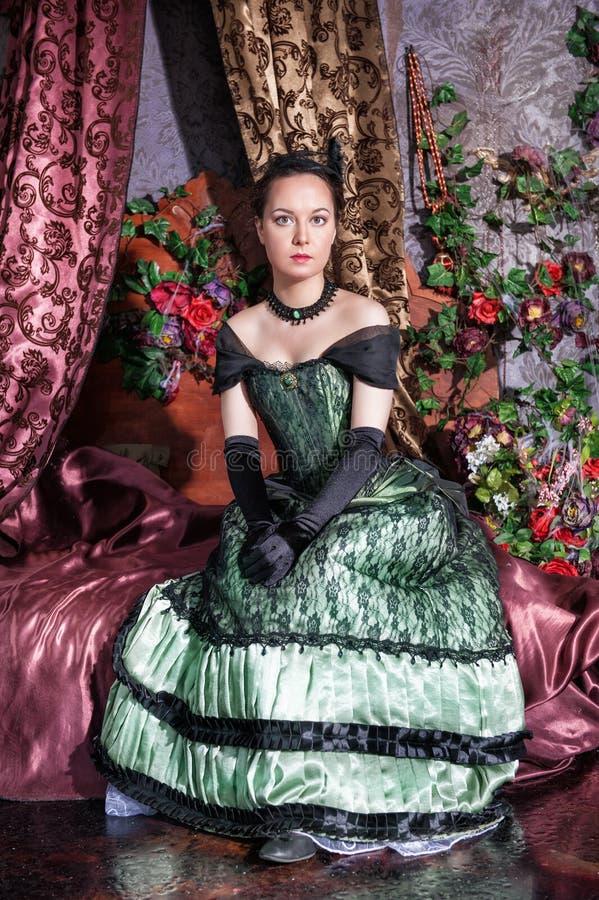 Beautiful woman in medieval dress. Beautiful young woman in long medieval dress and gloves royalty free stock photo