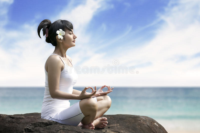 Download Beautiful Woman Meditating By The Sea Stock Photo - Image: 25053298