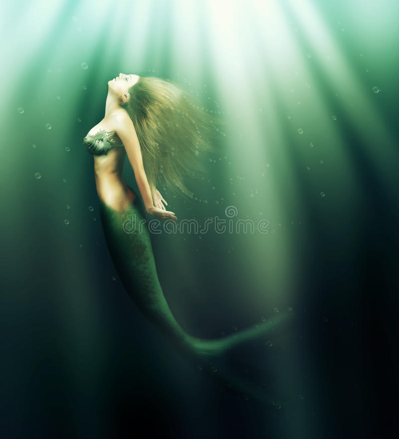 Beautiful woman mermaid with fish tail royalty free stock photos
