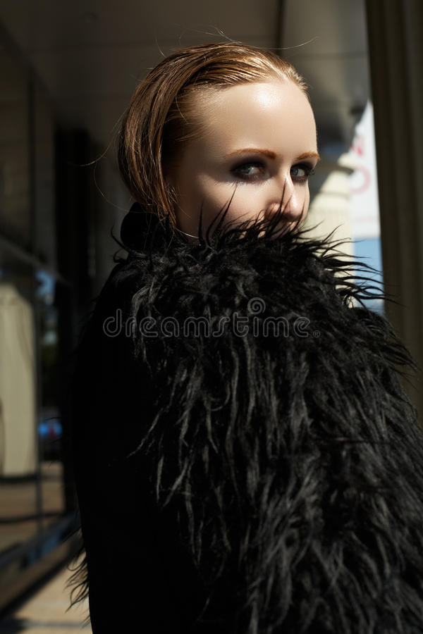 Download Beautiful Woman Model In Fashion Black Warm Jacket With Fluffy Fur Stock Photo - Image: 27082530