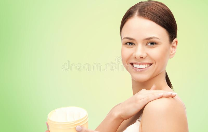 Beautiful woman with moisturizing cream stock images